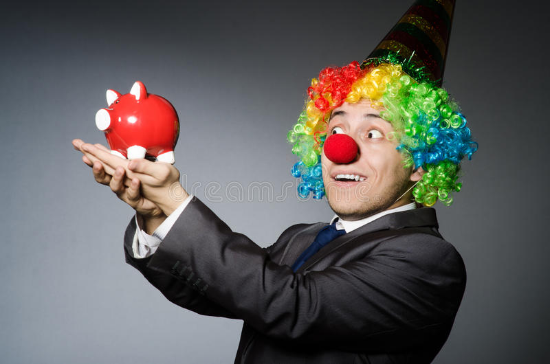 Download Clown with piggybank stock image. Image of caucasian - 42204859