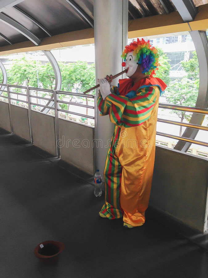 Clown playing flute royalty free stock photo