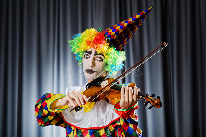 Download Clown playing on  violin stock image. Image of celebration - 26480609