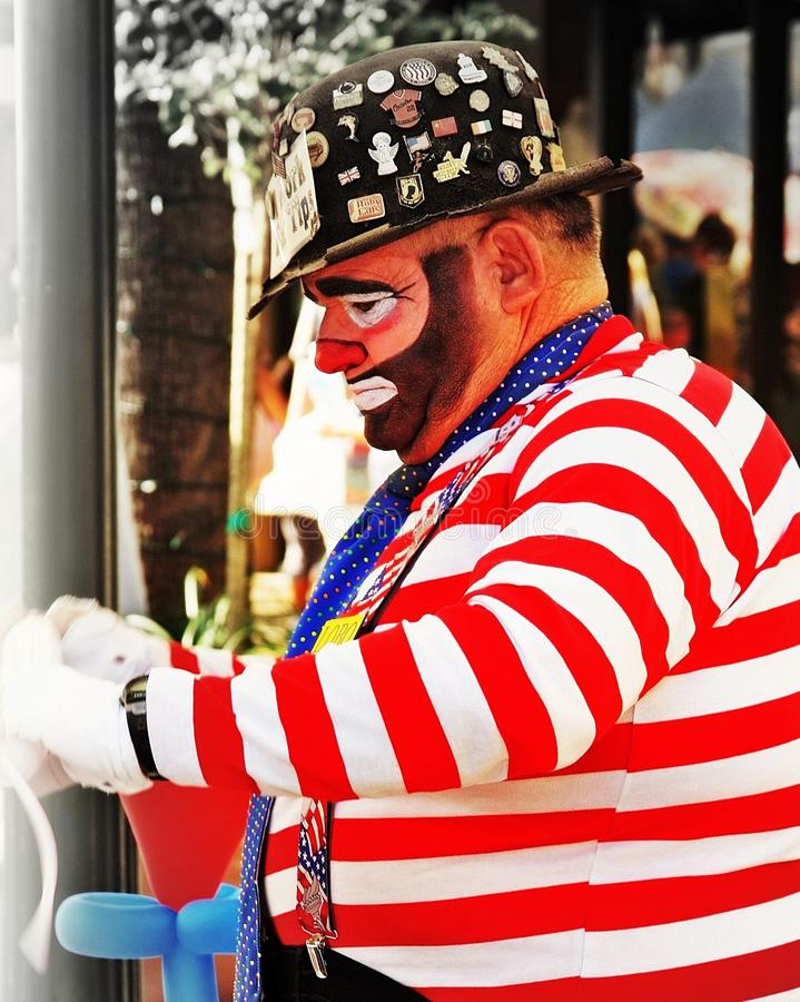 The clown is preparing for the show by getting his props ready. The clown begins to prepare for the show where he will entertain royalty free stock photos