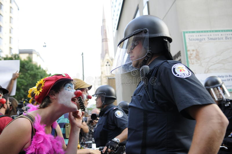 Clown protester. TORONTO-JUNE 25: Clown dressed activists teasing the police officers during the G20 Protest on June 25 2010 in Toronto, Canada stock photo
