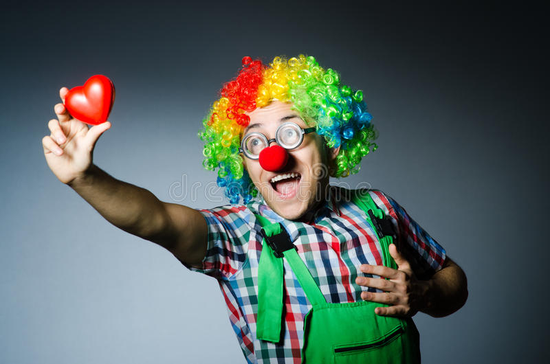 Clown with red heart. In romantic concept stock photography