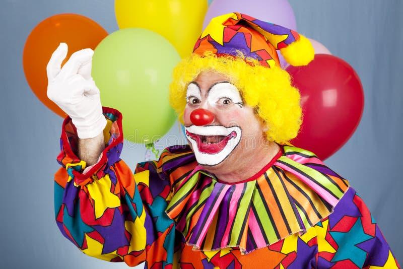 Clown reißt Finger stockbild
