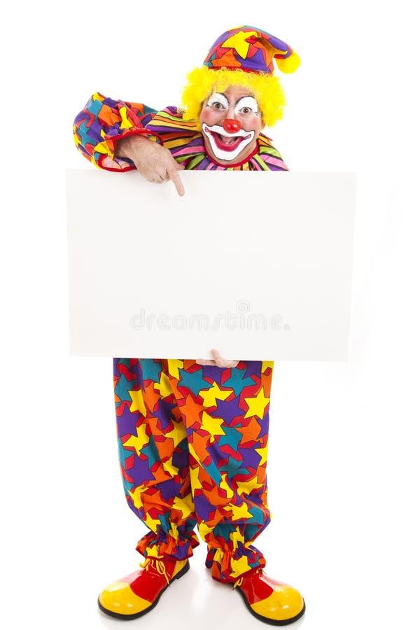 Clown retenant le signe blanc - plein fuselage photo stock