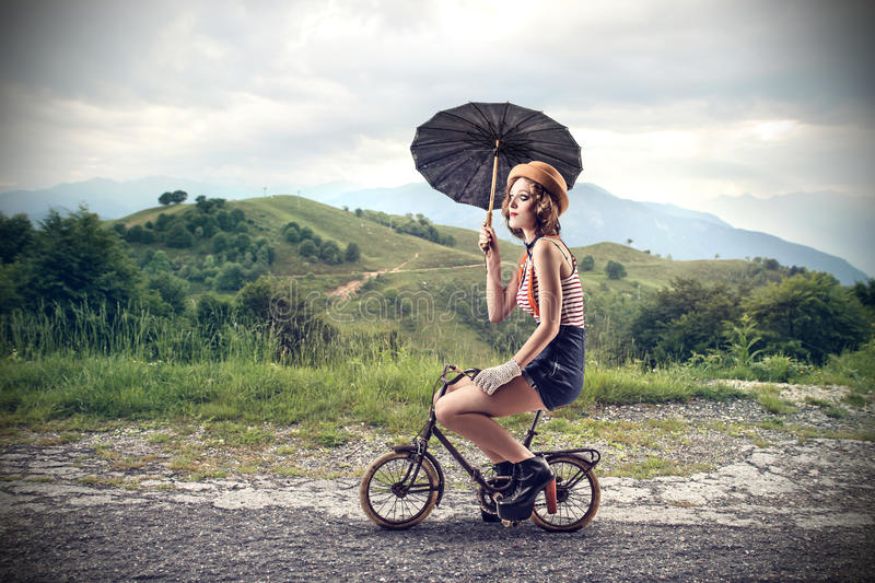 Download Clown Riding A Little Bike With An Umbrella Stock Image - Image of path, active: 39514331