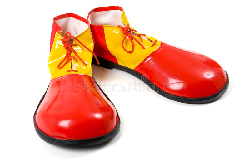 Clown-Schuhe auf Weiß lizenzfreies stockfoto