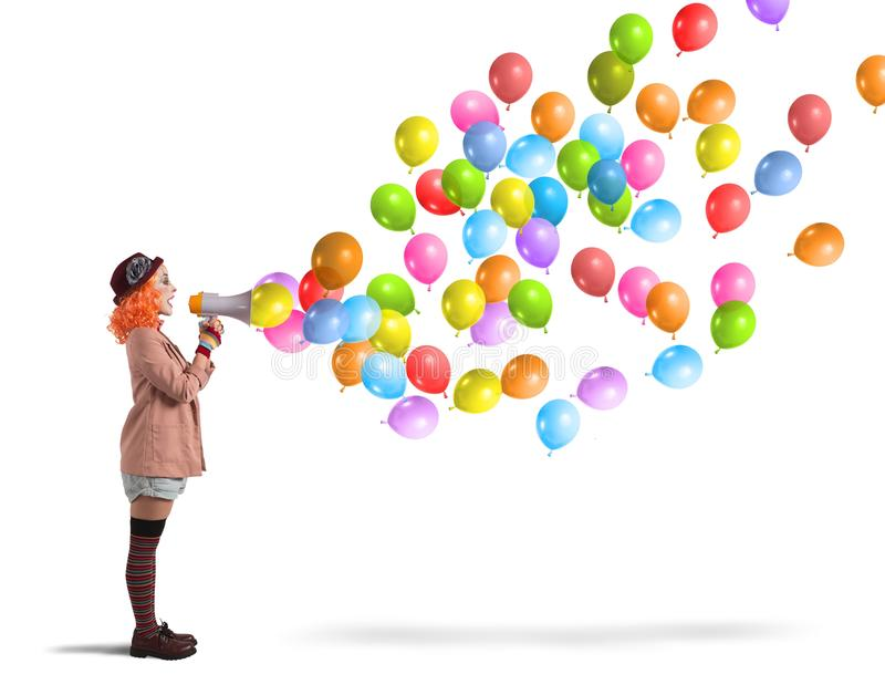 Clown screams balloons. Clown funny and creative screams colorful balloons stock images
