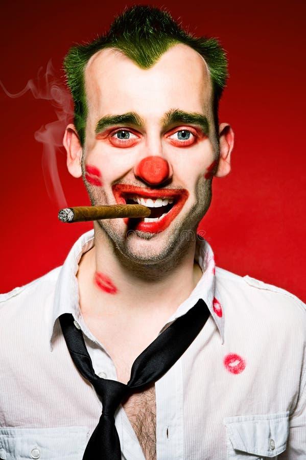 Clown smoking cigaro