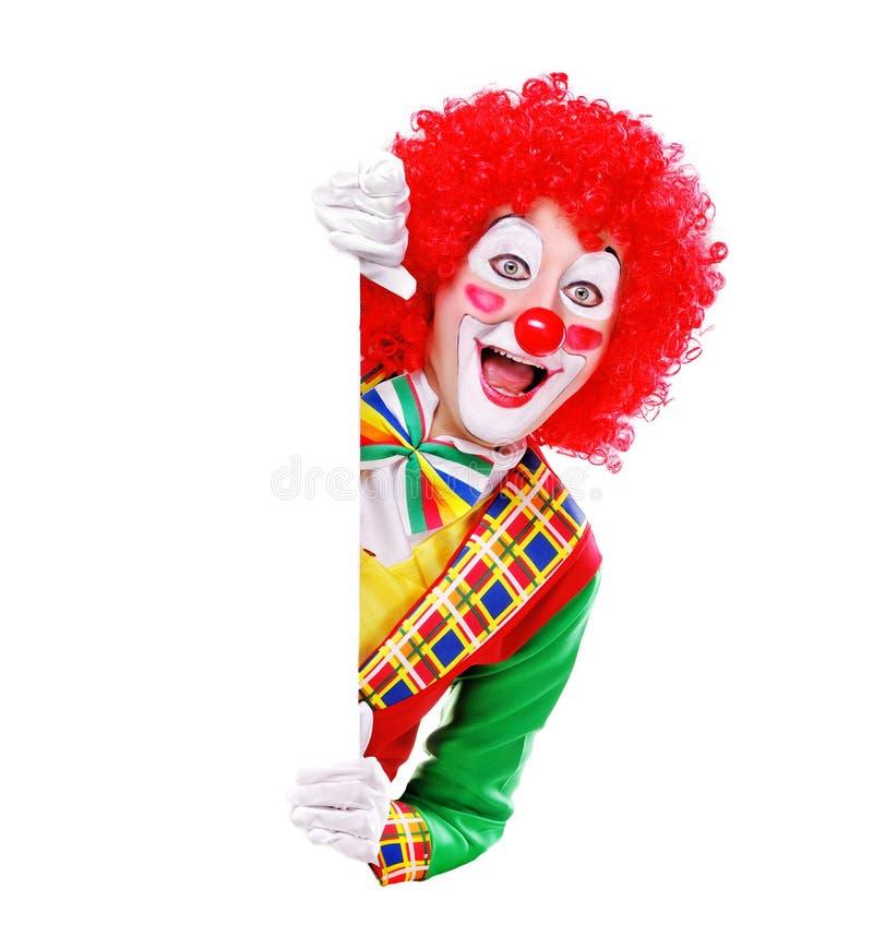 Clown som rymmer mellanrumet arkivbild