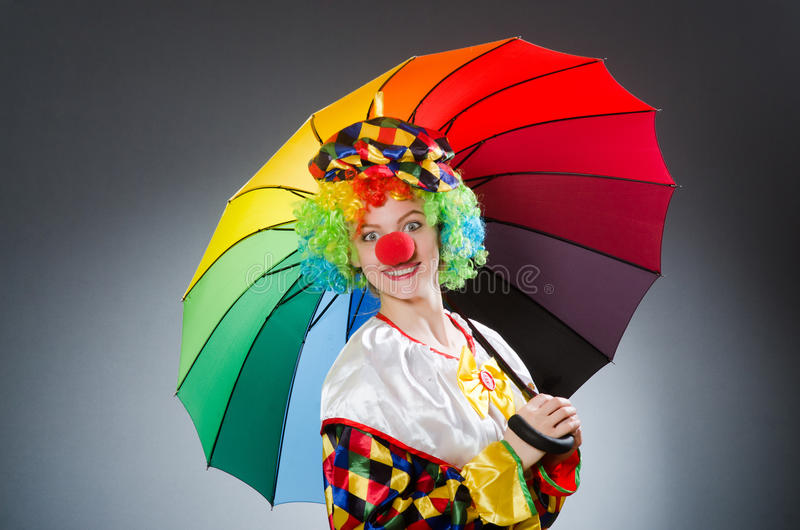 Clown with umbrella in funny concept. The clown with umbrella in funny concept royalty free stock photo