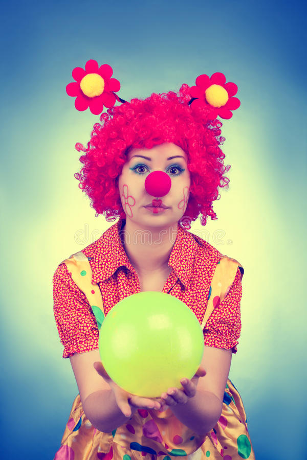 Clown Woman With A Ball Vintage Toned Stock Photo