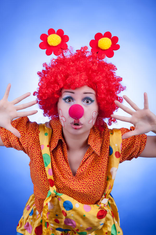 Download Clown Woman On Blue Background Studio Shooting Stock Photo - Image: 39762902