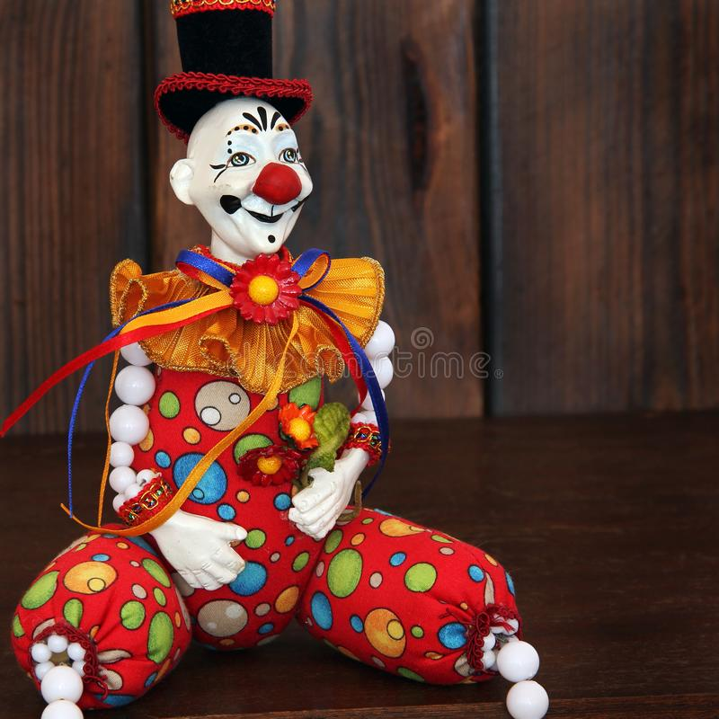 Clown on wooden background stock images