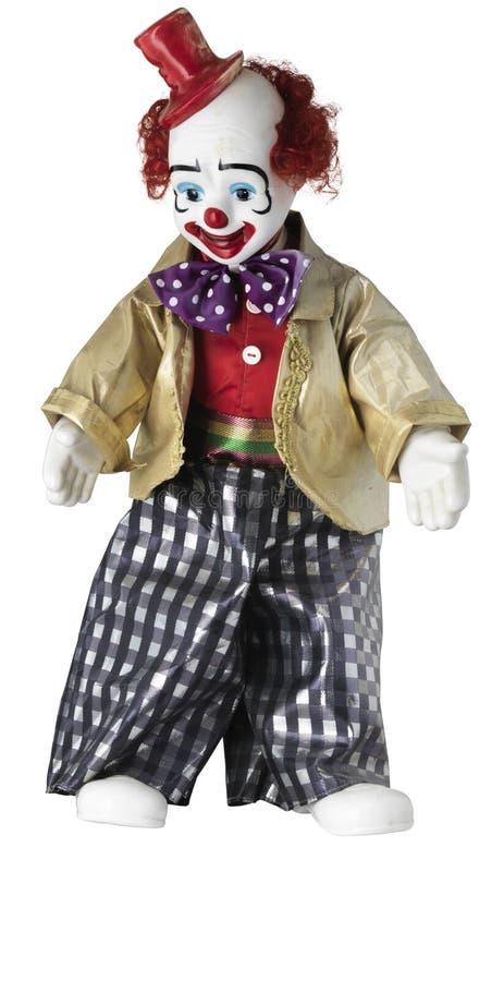 Clowndocka med den röda bästa hatten och den prickiga flugan arkivfoto