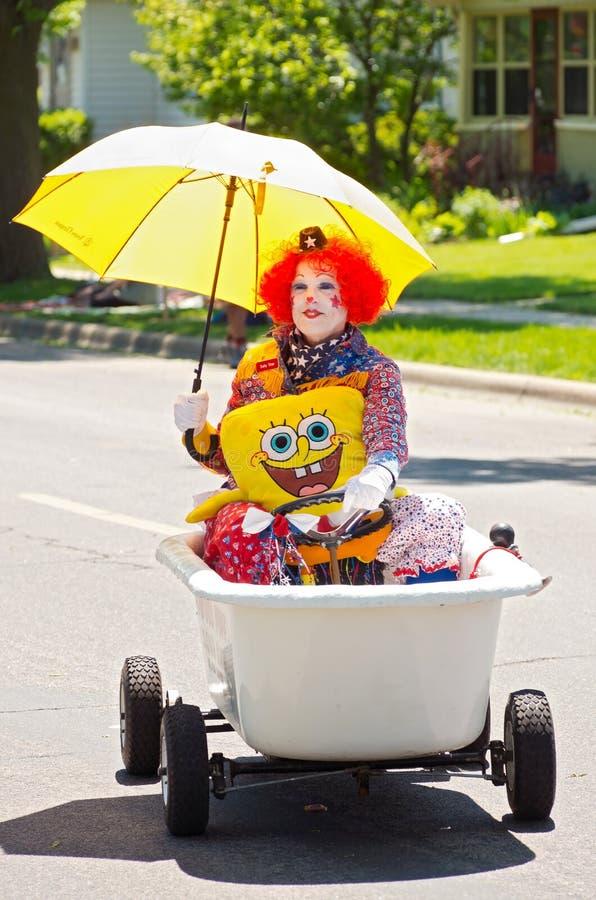 Clownen i badkar på ståtar royaltyfria foton