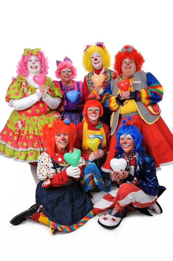 Clowns retenant des coeurs photo libre de droits