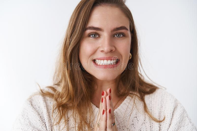 Clse-up charming charismatic cute upbeat adult woman asking friend rescue cover-up work, holding hands pray smiling. Needy, begging help standing supplicating royalty free stock image
