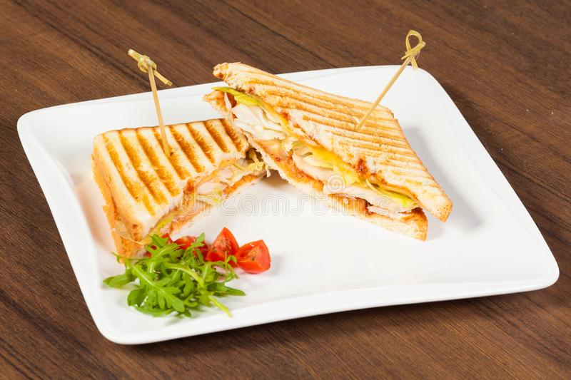 A club chicken sandwich on white plate stock images