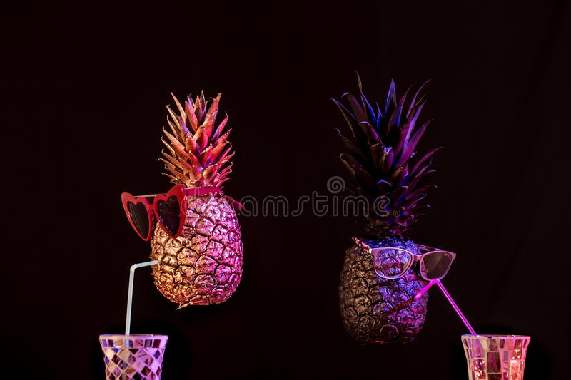Club concept ,black and gold pineapples in sunglasses stock photo