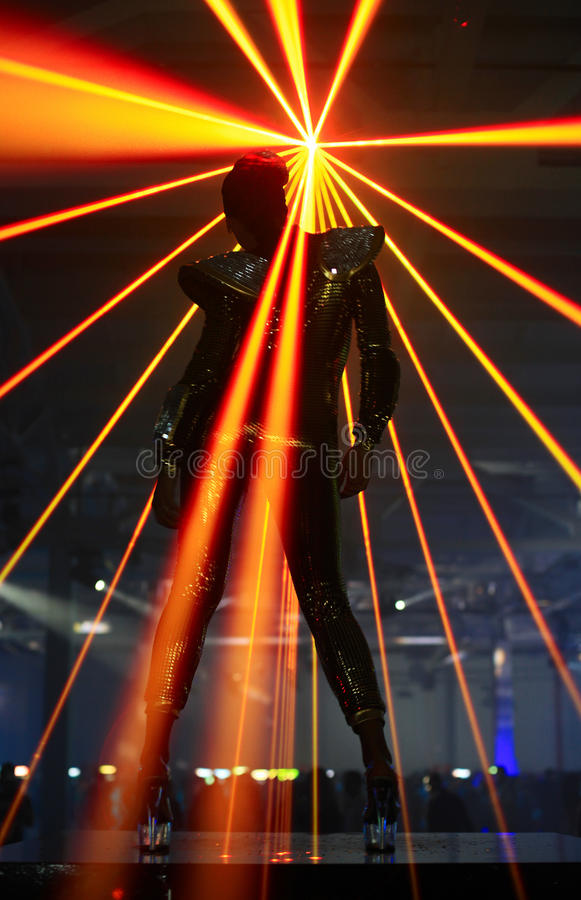 Club Dancer Against Laser Rays Royalty Free Stock Images