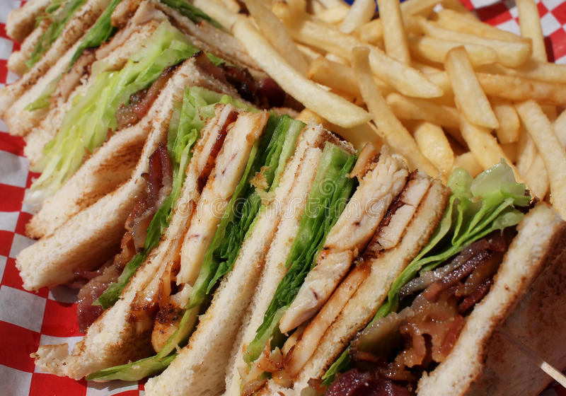 Club sandwich. Chicken club sandwich with french fries royalty free stock images