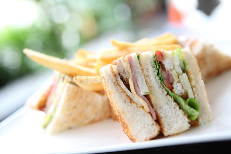 Club sandwich. And french fries in close up royalty free stock photography