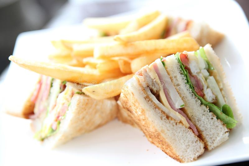 Club sandwich. And french fries in close up stock image
