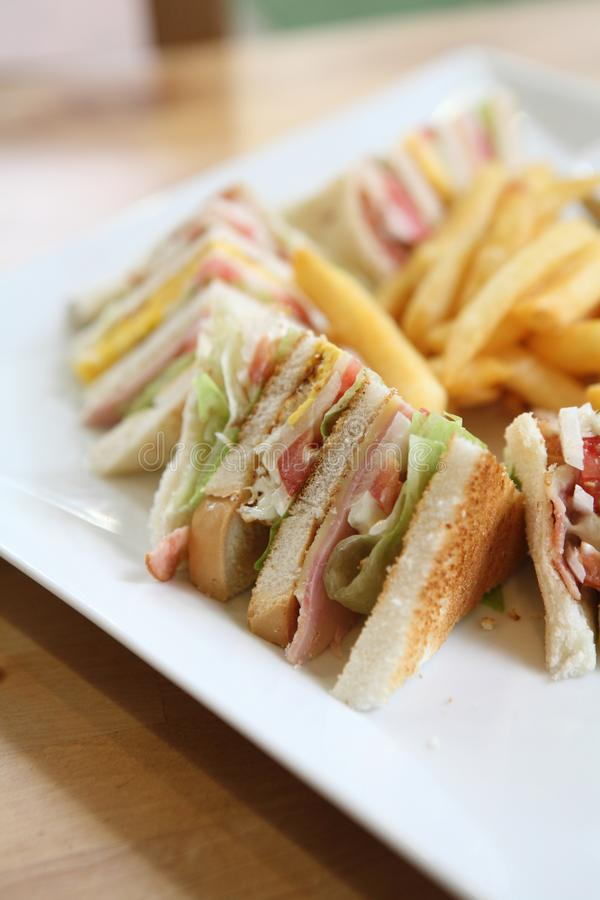 Club sandwich. And french fries royalty free stock photo