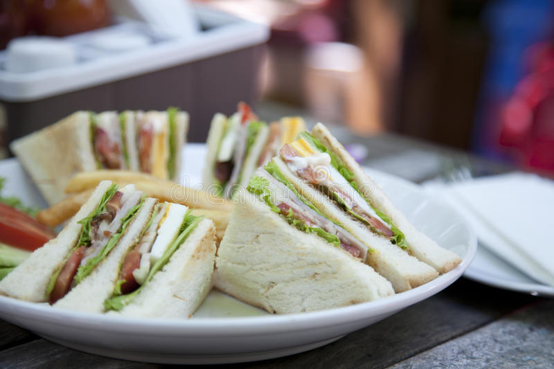 Club sandwich. With coffee on wood background royalty free stock images