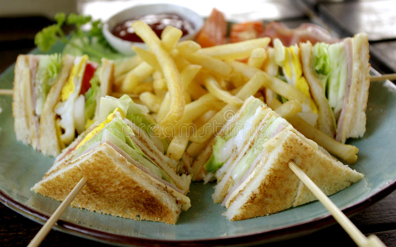 Club sandwich for breakfast. Club sandwich with baconfor breakfast royalty free stock images
