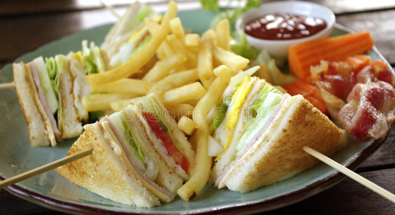 Club sandwich for breakfast. Club sandwich with baconfor breakfast stock photography