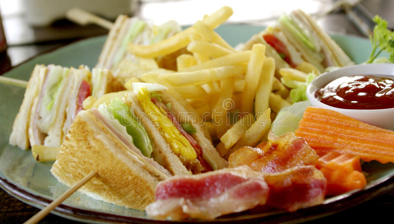 Club sandwich for breakfast. Club sandwich with baconfor breakfast royalty free stock image