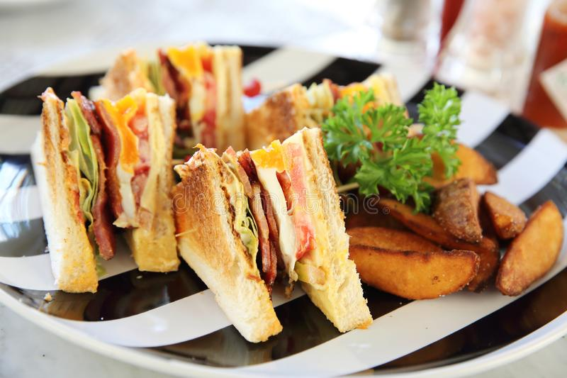 Club sandwich. Breakfast Club sandwich with chips royalty free stock images