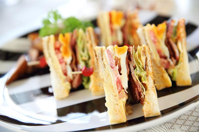 Club sandwich. Breakfast Club sandwich with chips royalty free stock image
