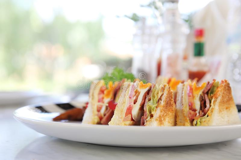 Club sandwich. Breakfast Club sandwich with chips royalty free stock photography