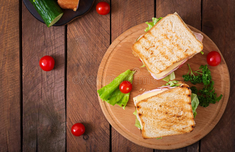 Club sandwich. With cheese, cucumber, tomato, ham and eggs stock photography