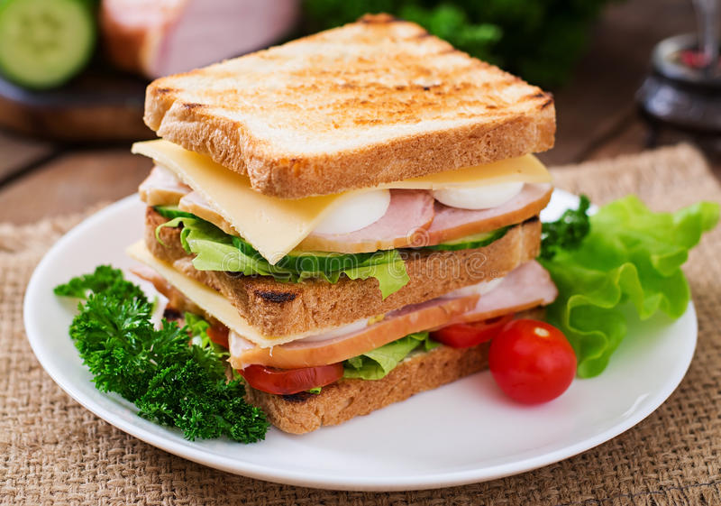 Club sandwich. With cheese, cucumber, tomato, ham and eggs stock images