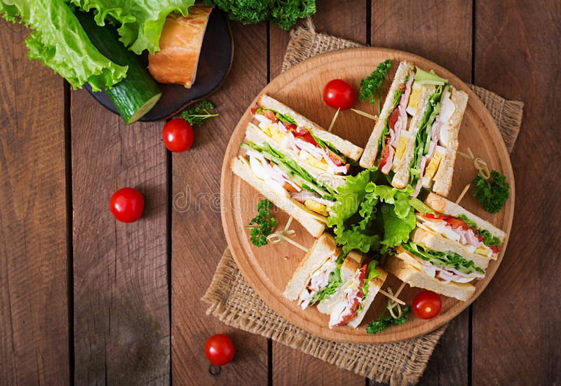 Club sandwich. With cheese, cucumber, tomato, ham and eggs. Top view stock images