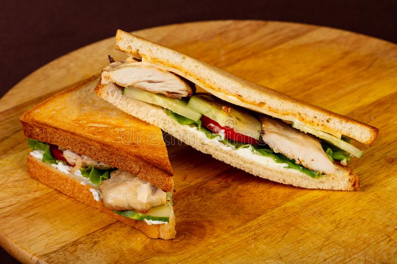 Club sandwich with chicken breast. And salad stock photography