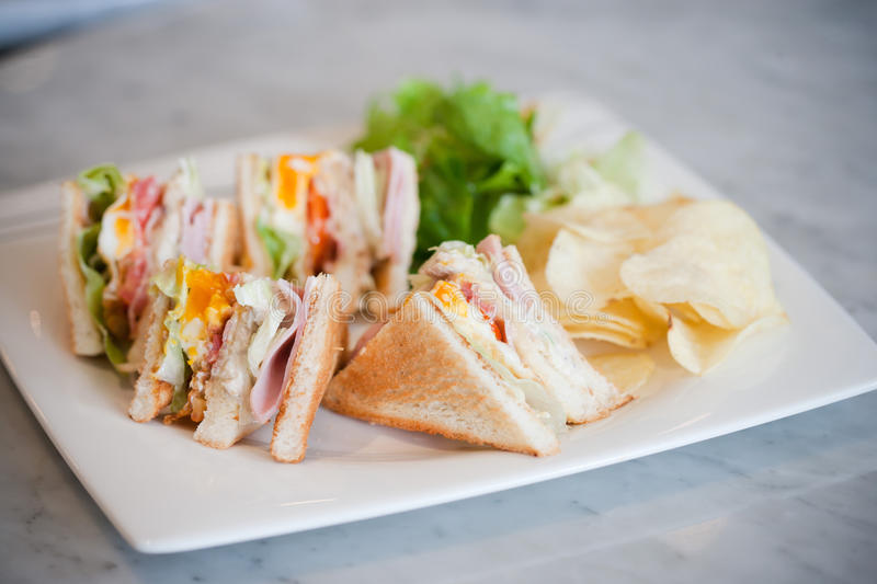 Club sandwich. Clubhouse Sandwich, with snack on the table royalty free stock photos