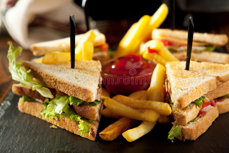 Club Sandwich with French Fries royalty free stock photography
