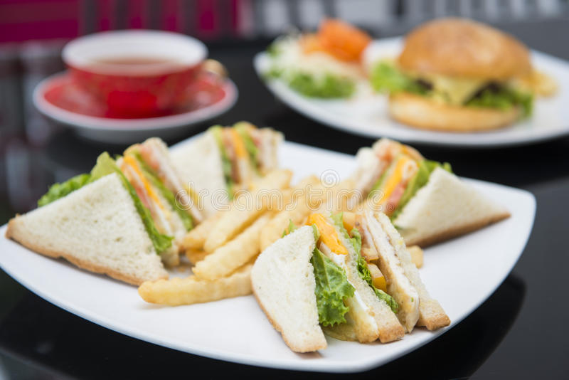 Club sandwich with french fries. Breakfast stock images