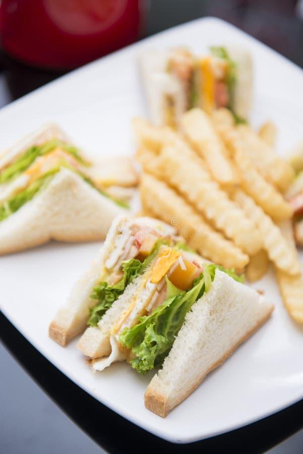 Club sandwich with french fries. Breakfast stock photos