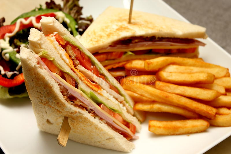Club sandwich with french fries. A delicious Club sandwich with french fries stock photos