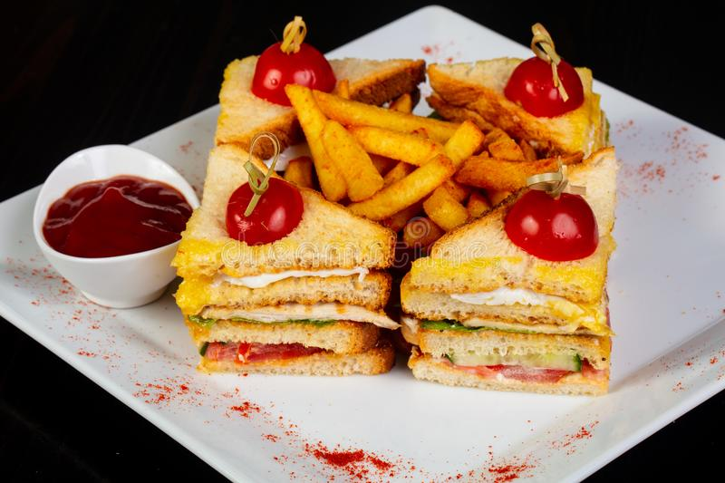 Club sandwich with french potato. And sauce stock photo