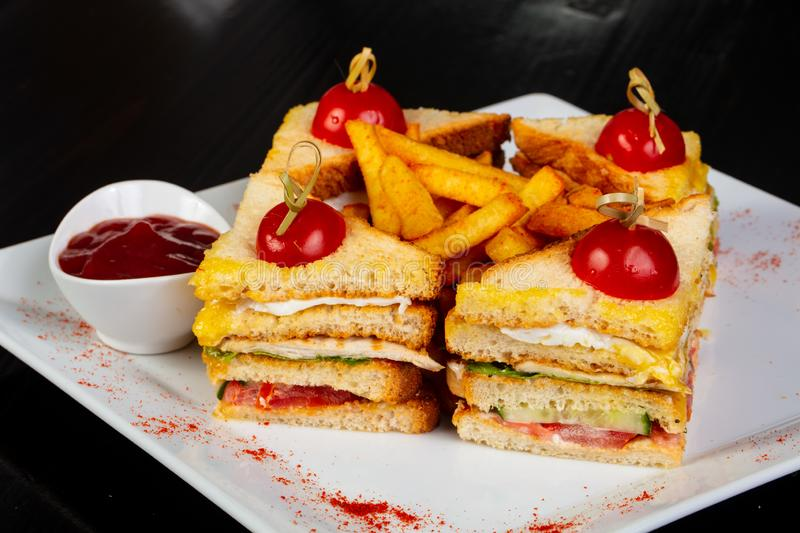 Club sandwich with french potato. And sauce stock images