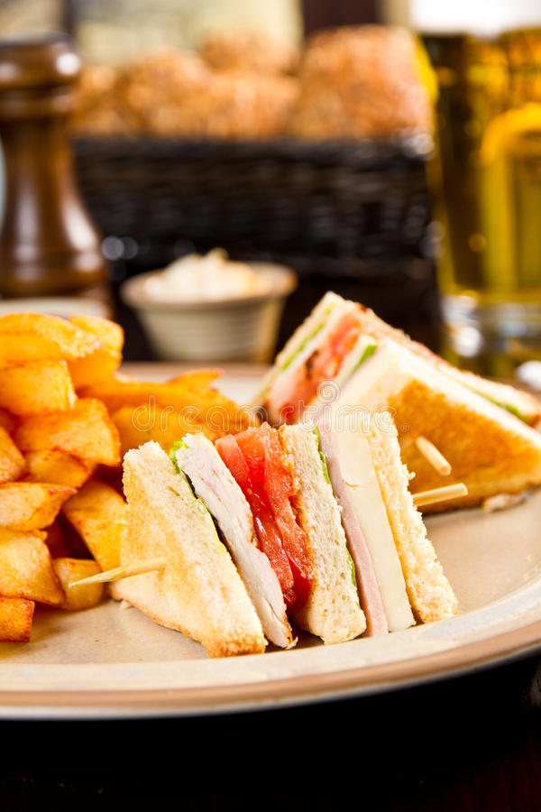 Club sandwich. With fries on a plate stock images