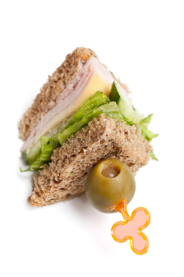 Club sandwich with ham and cheese. Club sandwich with ham, cheese,lettuce and cucumbers on whole wheat bread royalty free stock image