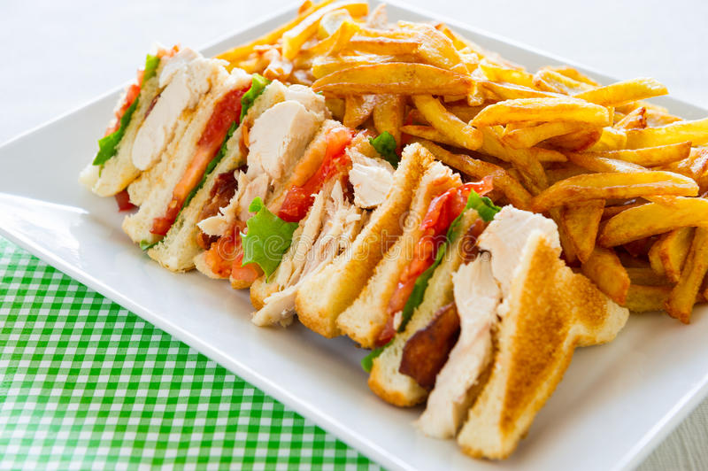 Club sandwich meal. Chicken club sandwich in a white plate. Meal time stock images