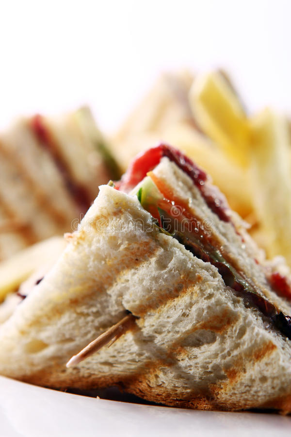 Club sandwich with meat and green. Club sandwich with salami and green royalty free stock photo